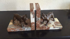 a pair of bookends with dogs on marble platforms, France, early 20th century
