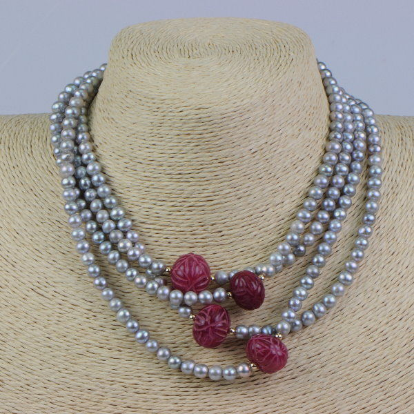 14 kt yellow gold necklace with freshwater cultured pearls and carved rubies