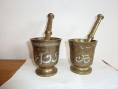 2 Old and richly decorated mortars and pestles - very heavy - silver inlays -