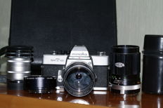 Minolta SRT 101 with lenses and macro accessories