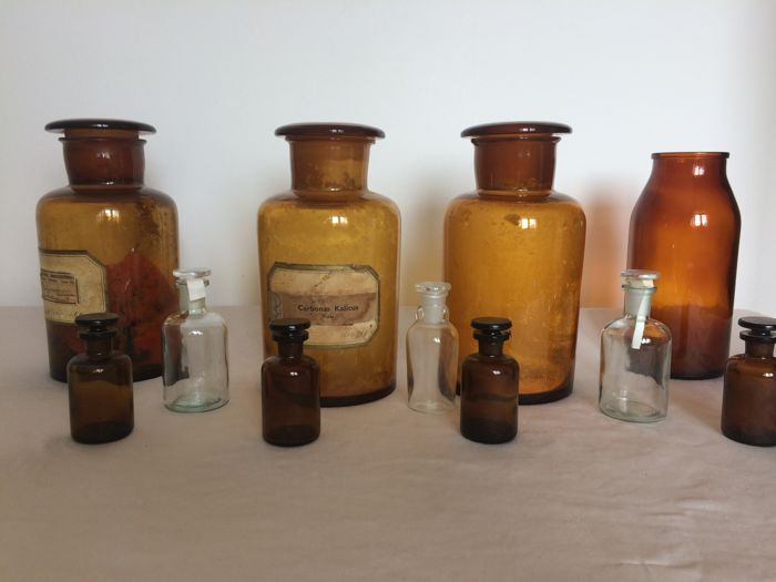 "Four large pharmacy bottles from the Netherlands and 7 ""Butterfly"" bottles from early 20th-century Germany"