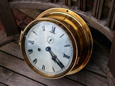 Urgos large-format glass-striking ship's clock in solid brass enclosure. Rare.