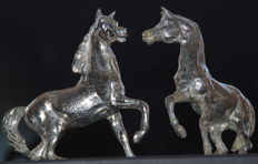A pair of silver-plated horses
