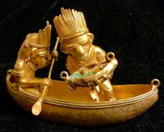 A fabulous , Tumbaga Gold and genuine columbian emeralds ,  anthropomorphic artefact , Colombia  , Tairona Culture ,  100 x 90 x 142 mm, 249,50 grams, An Indian native canoe with a fisherman (who have three genuine columbian emeralds in his basket with fi