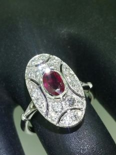 Art Deco entourage ring with ruby and diamonds.
