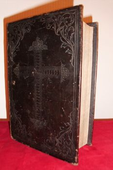 Bible from 1857 with a leather cover with an inlaid cross