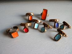 Lot of 9 enamelled bronze cocktail rings, all signed Saint Luc.