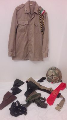 Interesting lot of various military items of a discharged soldier - various holsters, helmet, etc.