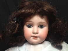 Armand Marseille, Germany - Length 50 cm - antique walking doll with porcelain head on wooden articulated body with walking mechanism no. 1894