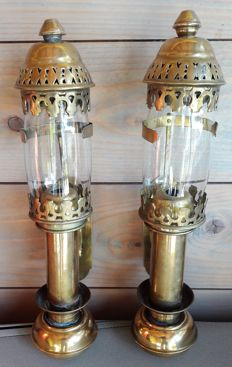 Two old brass rail car candlesticks