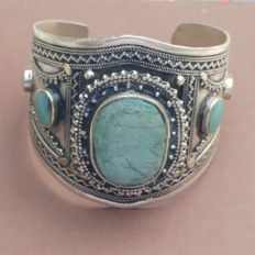 Wide silver bracelet set with turquoise