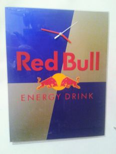 Big colck. RED BULL advertisement. Red Bull logo. Array + clock in one. Original Red Bull.