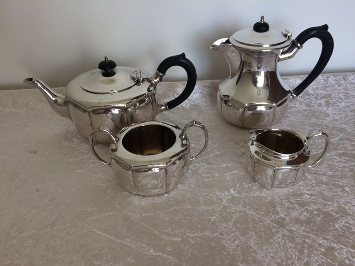 Silver plated 4 piece tea and coffee service from England from the mid - 20th century.