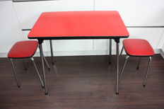 Manufacturer unknown - Vintage red kitchen table with matching stools.
