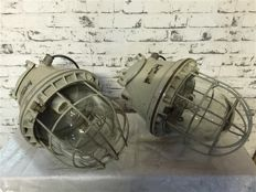A pair of unique large bunker / industrial lamps