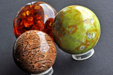 Unusual Serpentine, Synthetic Amber and Graphic Feldpspar spheres - 6.1 to 7.4 cm - 929 gm (3)