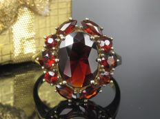 Old gold ring with garnet
