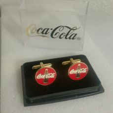 A Set Of Gold-Coloured Coca Cola cufflinks In Storage Box