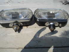 Two SPOTLIGHTS made by the brand LUCAS with a width of 180 mm from the 1970s and 1980s.