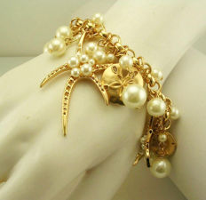 Gorgeous Joan Rivers gold tone charm bracelet