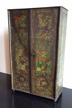 A hand-painted iron cabinet on ball feet, with four compartments and two doors with twist lock, the Netherlands, early 20th century