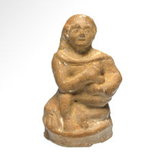 Egyptian Alexandrian Terracotta Figure of a Seated Child carrying a Dog,  9.3 cm. H.
