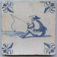 """Antique tile with the image of a """"fisherman - angler"""", Mid 17th century"""