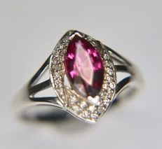 White 9Kt. Gold ring with a strong pink coloured Rhodolite enchanted by 36 point diamonds. [I/VS2] for a total of 0.74ct in an excellent condition
