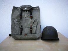 Swiss old military backpack (Rucksack) and helmet.