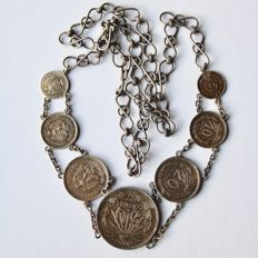 Antique of 1906 Old silver chain of Mexican Silver coins of 50, 20x2, 10x2and 5x2 coins connect together.