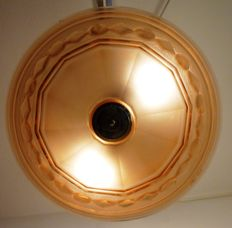 A soft red round glass hanging lamp ca 1930 with appropriate fittings