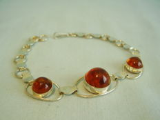 A handmade amber bracelet with 800 silver