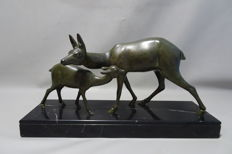 Large statue of two deer on marble base