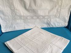 4 Antique cotton pillowcases [2 sets.] with lace and embroidery. The sizes are 75 x 80 cm and 60 x 60 cm.