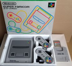 Super Nintendo console (Japanese import) with 2 controllers, universal power supply, Super Game Boy and game