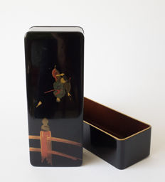 A black painted wooden fubako (letter container) decorated with a multicoloured maki-e  Ushiwakamaru (Minamoto no Yoshitsune) on Gojo Bridge  - Japan - Middle of the 20th century