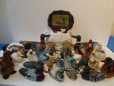 Collection of colourful ducks in various materials-wood, ceramics, brass