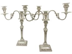 A pair of Victorian silver three-lights candelabra, London 1874