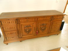 A solid oak sideboard with an open upper section, France, early 20 century