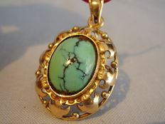 Antique golden pendant with natural turquoise cabochon