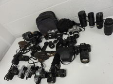 16 35 mm cameras and 3 lenses