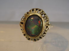 Antique golden ring with fiery opal.