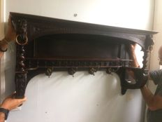 Antique coat rack with wooden lion head carvings and four hooks
