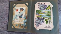 Old album with special postcards including embossed cards and cards with gold and silver etc. 94 x
