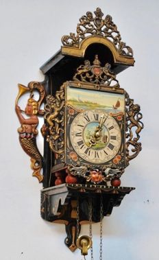 Bracket clock with weight. Very beautiful Painted details and Woodcarving – second half 20th century