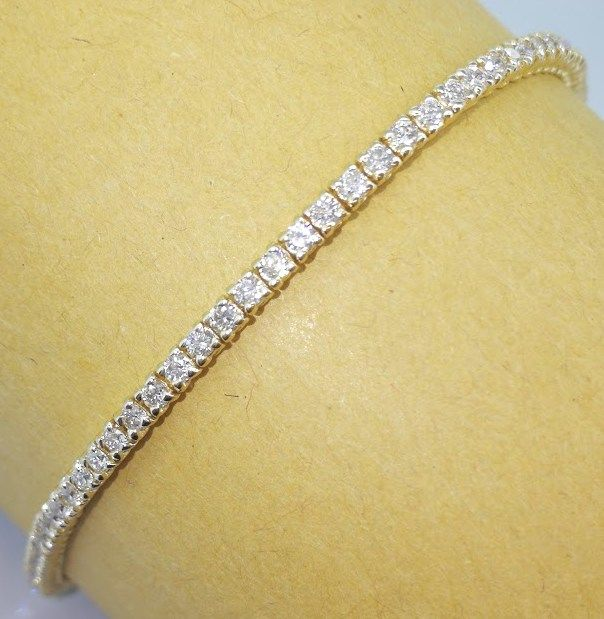 Tennis bracelet, set with 91 diamonds - 2.50 ct in total - 14 kt yellow gold - 6.20 g - length: 18.50 cm