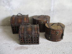 Four colonial suitcases with leather and copper fasteners