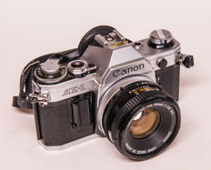Canon AE-1 with 135 mm and flash