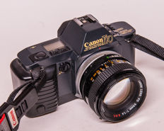 Canon T 70 with 1.4/50 mm, 4/200 mm and flash