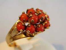 Golden ring with 10 Mediterranean coral spheres.